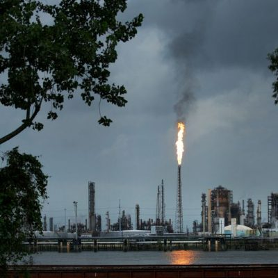 1163083908/ NORCO, LA - AUGUST 21: A gas flare from the Shell Chemical LP petroleum refinery illuminates the sky on August 21, 2019 in Norco, Louisiana. Located about 10 miles up the Mississippi River from New Orleans, the plant agreed to install $10 million in pollution monitoring and control equipment in 2018 to settle allegations that flares used to burn off emissions were operating in violation of federal law (the Clean Air Act). Many of the coastal parishes in Louisiana have a long and ongoing history in oil and gas production, which is often at odds with concerns of environmentalists. (Photo by Drew Angerer/Getty Images)